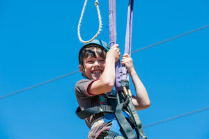 Boy smiling on Giant Swing