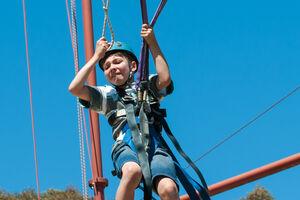 Fearful boy on Giant Swing