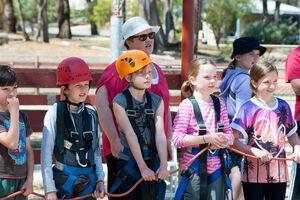 Group of children on Giant Swing pull team
