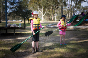 Two students preparing for canoeing