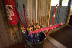 Red bows and coloured arrows in bucket