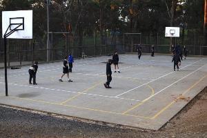 Students on camp playing basketball