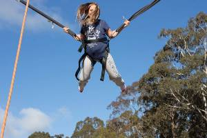 Girl jumping on Bungee Trampoline