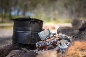 Billy tea boiling on a campfire