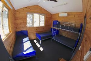 Timber style cabin with bunk and single beds