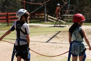 Two students ready to run on the giant swing pull team
