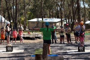 Instructor give school group instructions before starting milk crate stacking