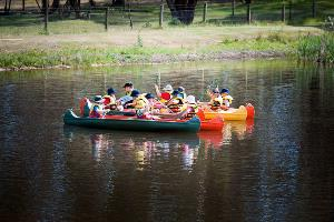 School group rafting up on in canoeing activity