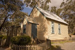 Small cream white chapel in bush setting