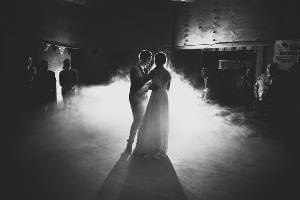 Bridal couple having their first dance in the barn hall