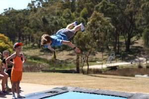 Boy doing backflip on trampoline